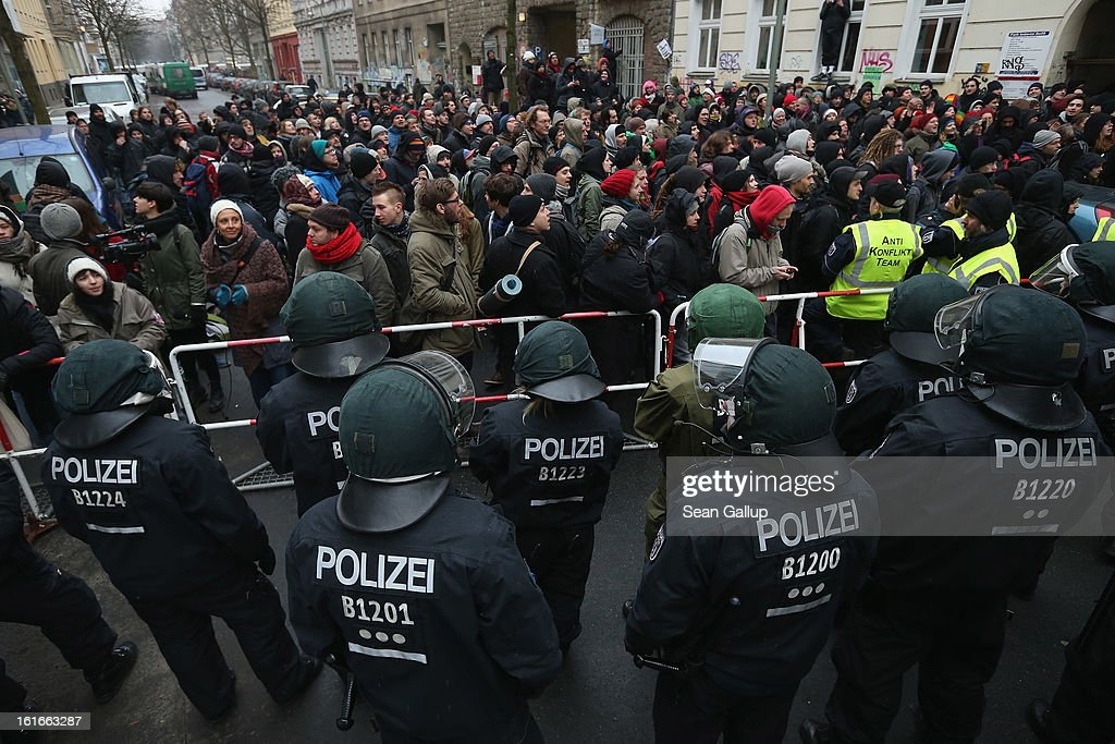 Protesters demonstrate near the entrance to Lausitzer Strasse 8 to prevent the eviction of the German-Turkish Gulbol family as riot police look on on February 14, 2013 in Berlin, Germany. Several hundred protesters arrived to demonstrate in support of Ali Gulbol, his wife and two sons, who face eviction from their apartment in Kreuzberg district despite the fact that they invested EUR 20,000 into their apartment and have paid all their outstanding rent, albeit behind schedule. The case is highlighting an ongoing controversy over gentrification in parts of Berlin, where rising housing prices are luring investors and forcing long-standing tenants out.