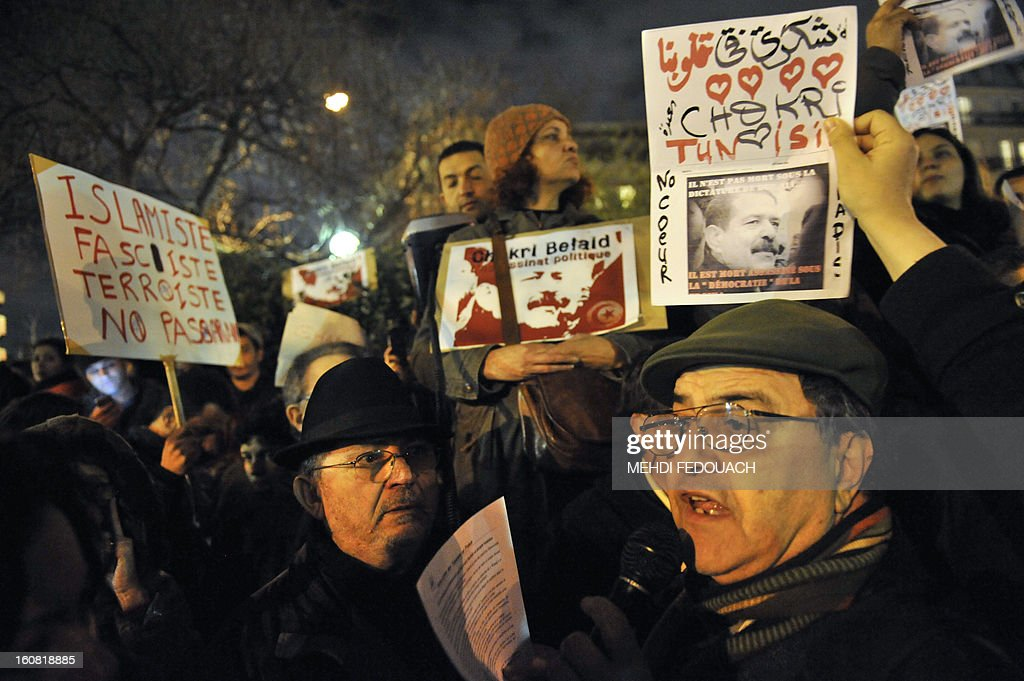 Protesters demonstrate on February 6, 2013 outside the Tunisian embassy in Paris against the killing today of prominent Tunisian opposition leader Chokri Belaid. Furious protesters on February 6 erected barricades in central Tunis and hurled rocks at police who tried to disperse them with tear gas in new clashes after the assassination of a prominent opposition figure.