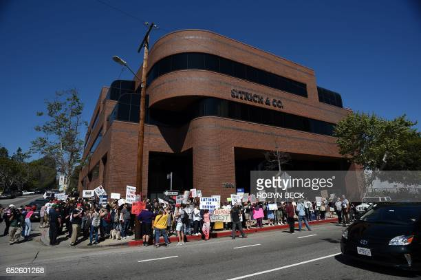 Protesters demonstrate on the street outside what they say is the offices of Breitbart News March 12 2017 in Los Angeles California to stand against...