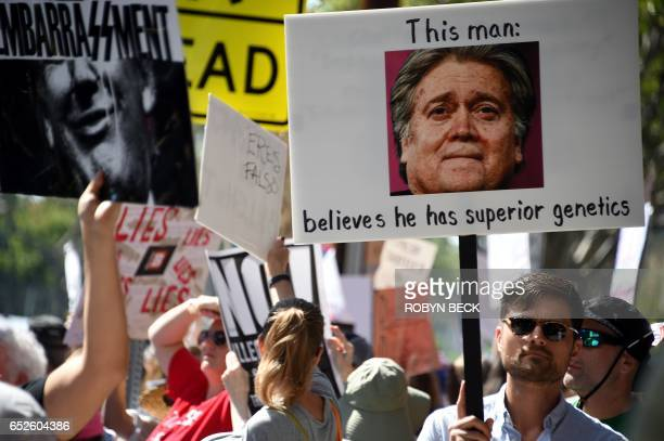 Protesters demonstrate on the street outside what they say is the offices of Breitbart News formerly run by Trump administration chief strategist...
