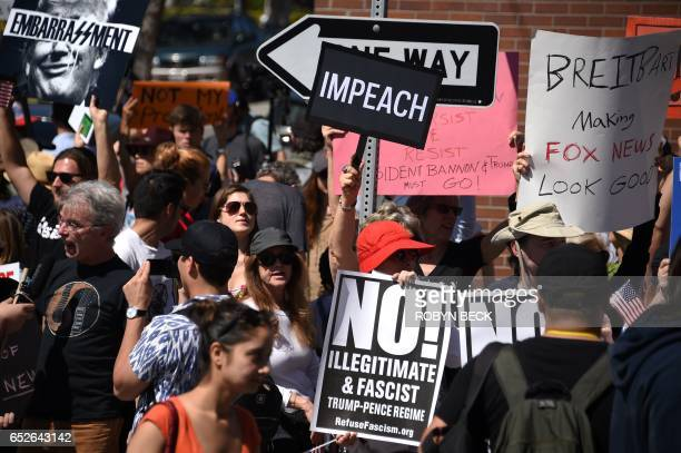 Protesters demonstrate on the street outside what they say is the offices of Breitbart News March 12 2017 in the Brentwood area of Los Angeles...