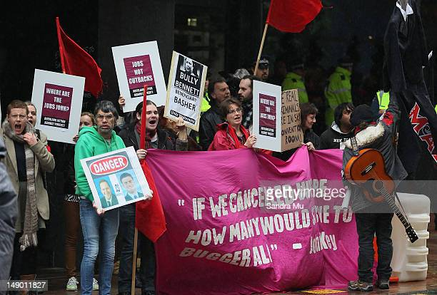 Protesters demonstrate outside the National Party Annual Conference at Sky City Convention Centre on July 22 2012 in Auckland New Zealand A small...