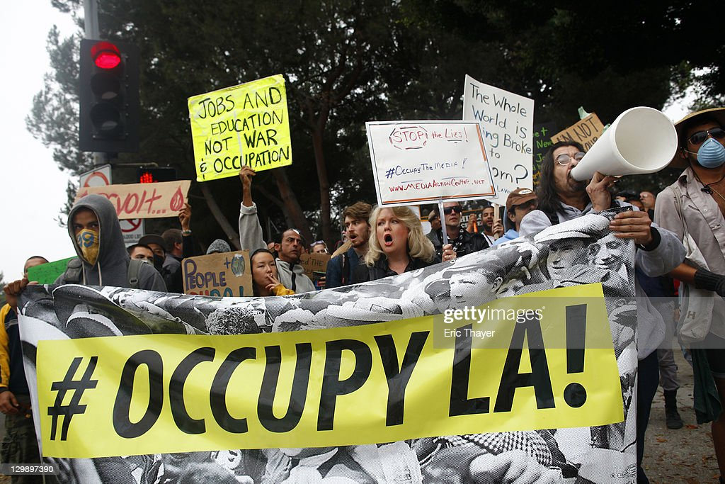 Protesters demonstrate the annual shareholder meeting of News Corp at Fox Studios October 21, 2011 in Century City, California. Protesters are demonstrating against Fox and News Corp's for what they see as one-sided reporting practices.