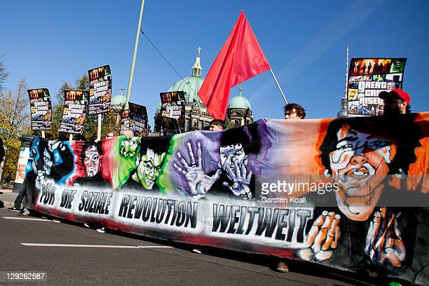 Protesters demonstrating against the influence of bankers and financiers march with banners on October 15 2011 in Berlin Germany Thousands of people...