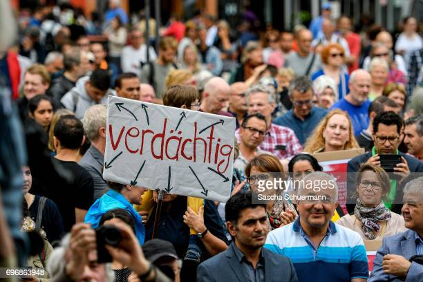 Protesters demonstrating against the Terror at a Muslims March on June 17 2017 in Cologne Germany The event takes place under the motto 'Not with us...