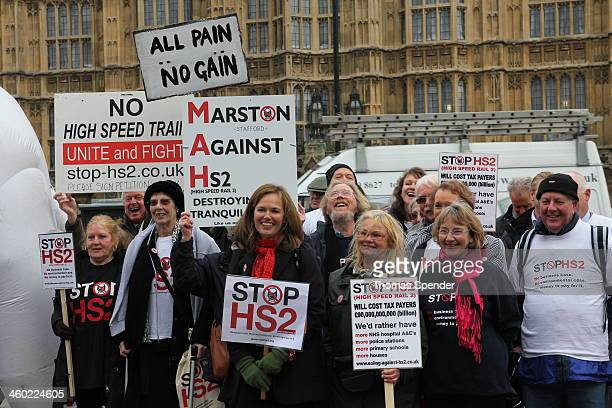 CONTENT] Protesters demonstrating outside the Houses of Parliament against the proposed HS2 high speed rail link between London and Birmingham They...