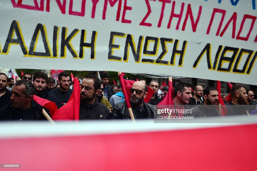 TOPSHOT - Protesters demonstratre in front of the Greek parliament in Athens, during a 48-hour general strike, on May 6, 2016. Greece's labour unions stage a two-day general strike to protest controversial government plans to overhaul pensions and increase taxes to meet demands of its bailout creditors . / AFP / LOUISA