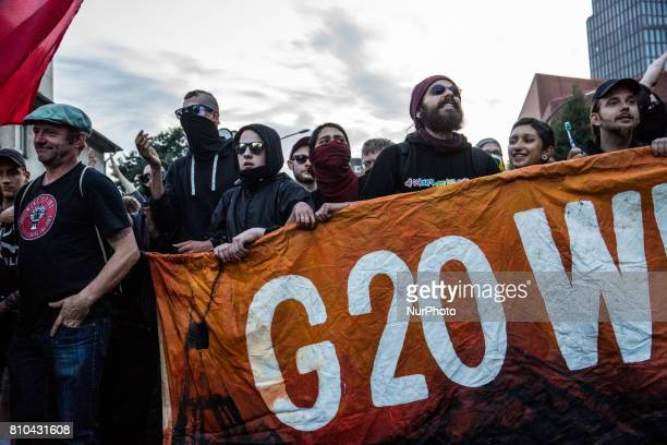 Protesters demostrate with a 'G20 Welcome to hell' banner as they take part in the 'Welcome to Hell' protest march on July 6 2017 in Hamburg Germany...