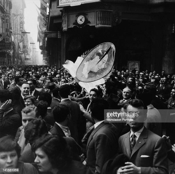 Protesters destroying a picture of President Juan Peron during a protest march against the government Buenos Aires September 1955