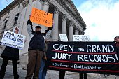 Protesters display a banner and placards during a demonstration outside the courthouse in New York's borough of Staten Island on January 5 before a...