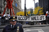 Protesters display an 'occupy wall street' banner outside of Zuccotti Park in New York US on Tuesday Nov 15 2011 New York City police pushed into the...