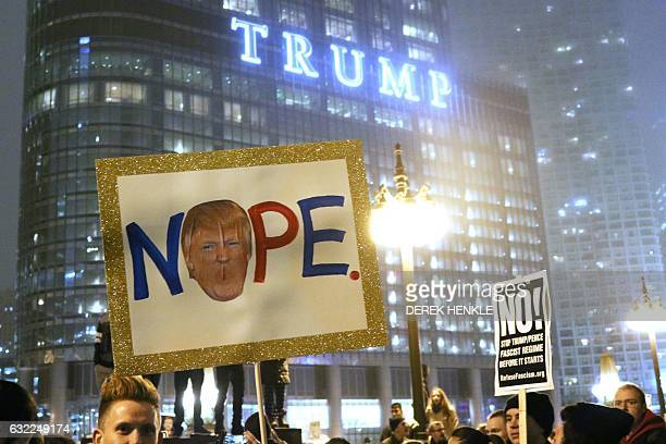 Protesters display banners reading antiTrump slogans in Downtown Chicago on January 20 2017 a few hours after the inauguration ceremony for Donald...