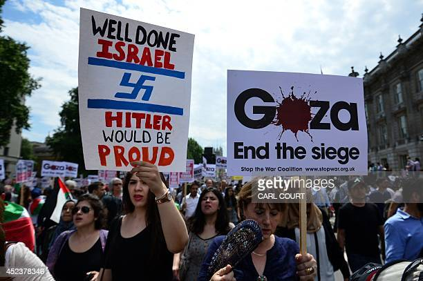 Protesters display placards and banners as they take part in demonstration against Israeli airstrikes in Gaza in central London on July 19 2014...