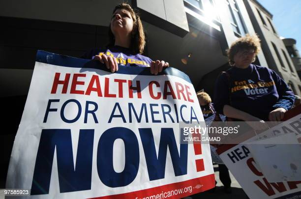 Protesters display placards supporting US President Barack Obama�s healthcare reform during a demonstration in Washington DC on March 9 2010 A...