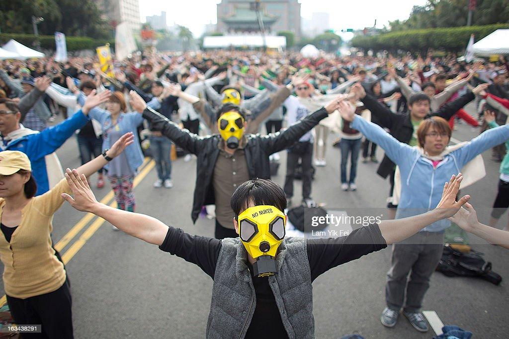 Protesters do morning exercise after camping overnight outside the Taiwan presidential palace on March 10, 2013 in Taipei, Taiwan. Tens of thousands of protesters took to the streets in Taiwan calling on the government to shut down the island's nuclear power plants, citing the painful lesson of Japan's nuclear crisis after a 9.0-magnitude earthquake two years ago.