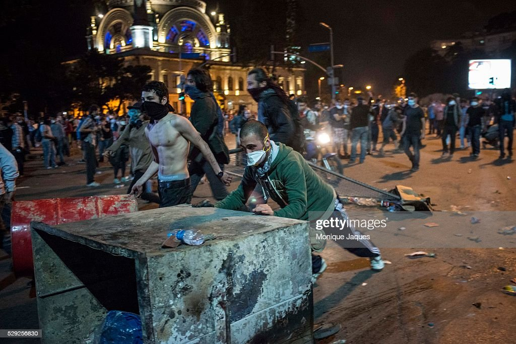 Protesters drag police gates and other debris to make baricades to block the police from entering Taksim Square On the 6th day of protests in...