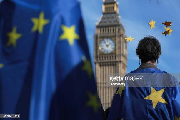 Protesters draped in European Union flags stand in front of Elizabeth Tower commonly referred to as Big Ben during a Unite for Europe march to...