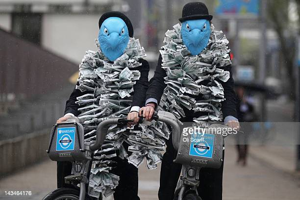 Protesters dressed as suited eagles on Barclays cycle hire bikes demonstrate outside the Royal Festival Hall which is hosting the Barclays bank AGM...