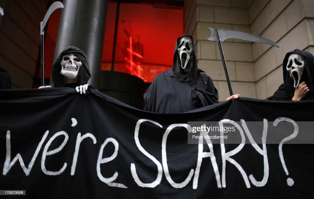 Protesters dressed as the Grim Reaper stand outside arms manufacturer BAe Systems on June 12, 2013 in London, England. Protests are expected to take place in London in the lead up to the G8 meeting to be held in Enniskillen, Northern Ireland on the 17 and 18 June 2013. The chosen location is only 8 kilometers from the scene of one of Northern Ireland's worst killings back in 1987, however Cameron is confident that it's secluded location will deter any potential trouble.