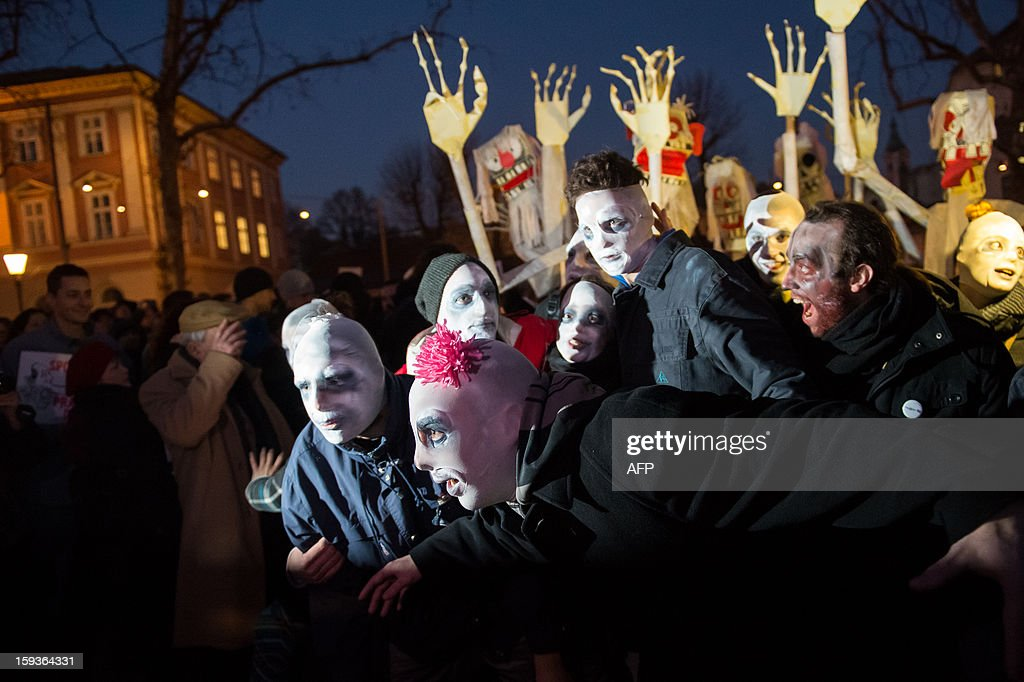 Protesters dressed as zombies pose for photographers during a demonstration against political corruption and the Prime Minister in Ljubljana, on January 11, 2013. Several thousand people in Slovenia's capital today joined in one of the biggest anti-government rallies in recent months, demanding the resignation of Prime Minister Janez Jansa, who has been accused of corruption. State radio estimated over 10,000 people took part in the protest called by civil groups under the slogan 'For the government's resignation and the renewal of Slovenia.' Police put the figure closer to 8,000. AFP PHOTO / Jure Makovec