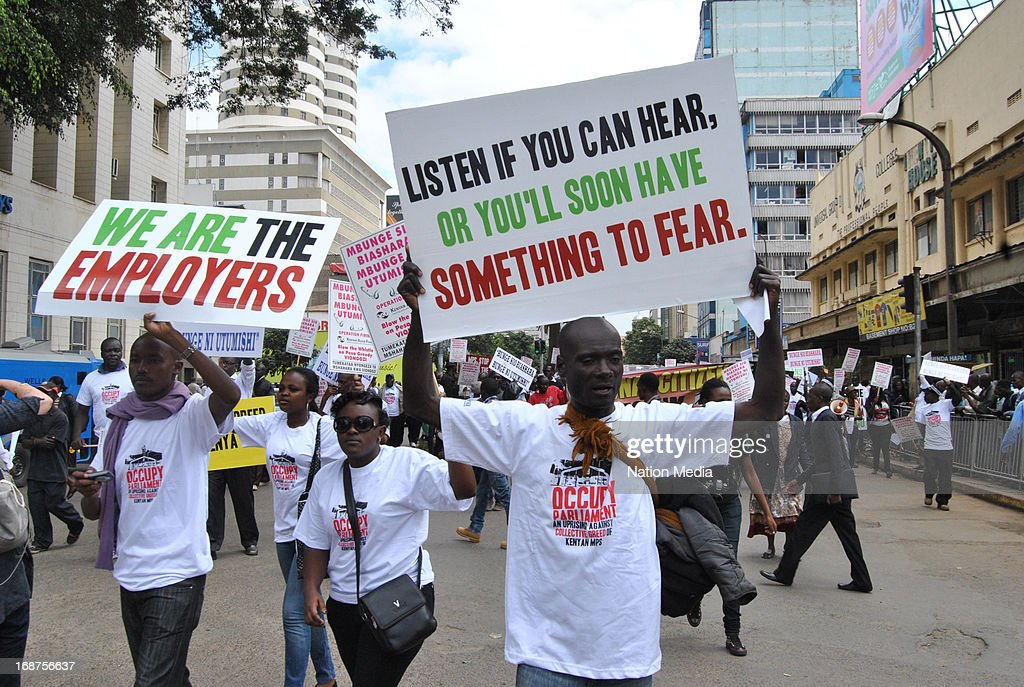 Protesters during a march against MPs pay on May 14, 2013 in Nairobi, Kenya. A large number of Kenyans are angry at the demand by newly elected MPs for higher salaries.