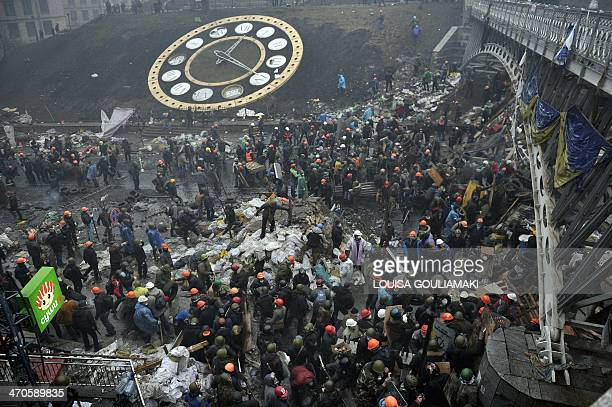 Protesters erect new barricades as they advance to new positions near Independence square in Kiev on February 20 2014 Hundreds of armed protesters...