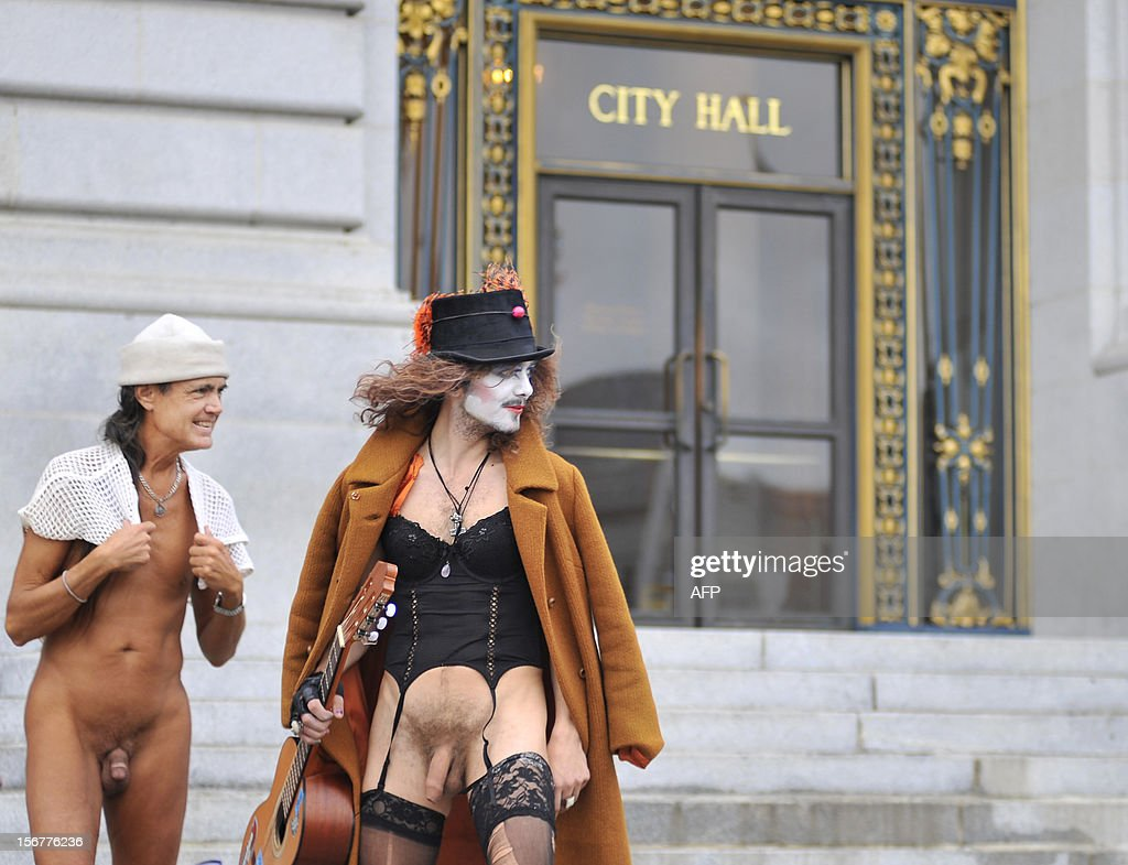 Protesters expose themselves on the steps of San Francisco's City Hall after the city's Board of Supervisors approved a ban on public nudity on November 20, 2012. San Francisco lawmakers voted to outlaw most public nudity, despite protests in the famously free and easy California city -- including a naked demo outside City Hall. The city's Board of Supervisors approved a ban proposed by Scott Wiener; its Castro neighborhood is a gay hub where so-called Naked Guys regularly hang out. The law was approved by 6 votes in favor to 5 against at an afternoon meeting, at which Wiener said the move was long overdue. AFP PHOTO/Josh Edelson