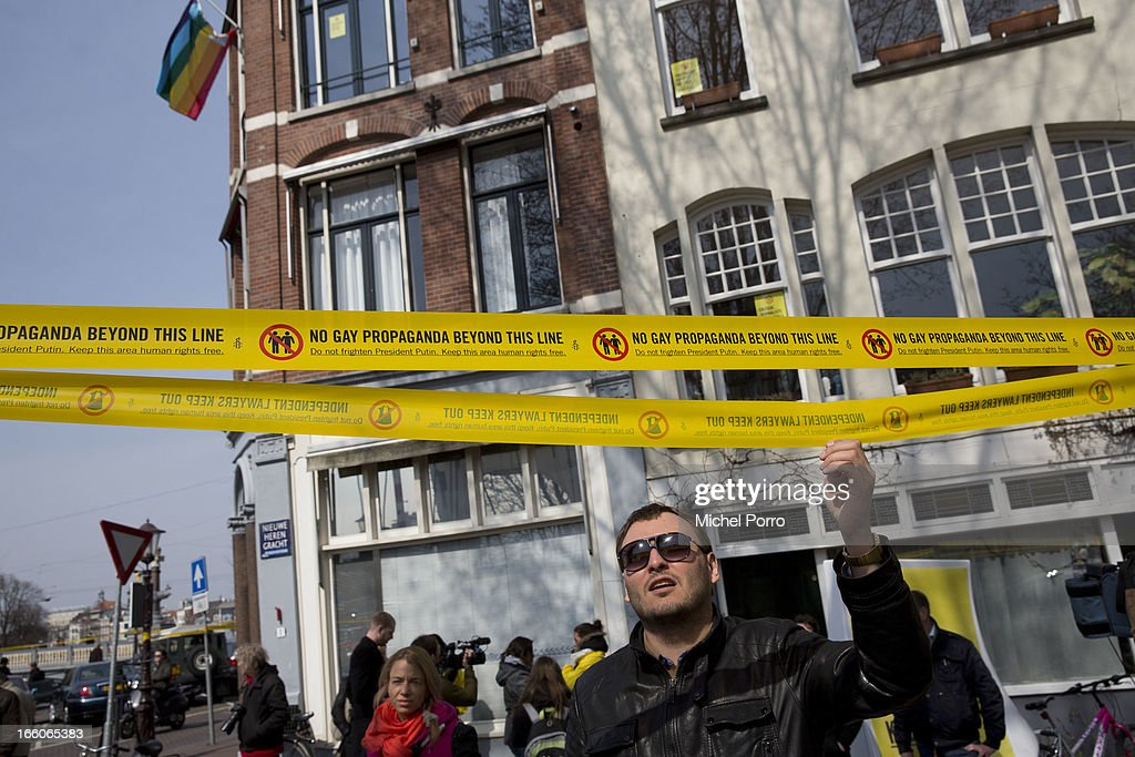 . Protesters express their ideas as President Putin meets Queen Beatrix of The Netherlands at Tsar Peter Exhibition on April 8, 2013 in Amsterdam, Netherlands. Putin began a one-day state visit to the Netherlands at the invitation of Queen Beatrix.