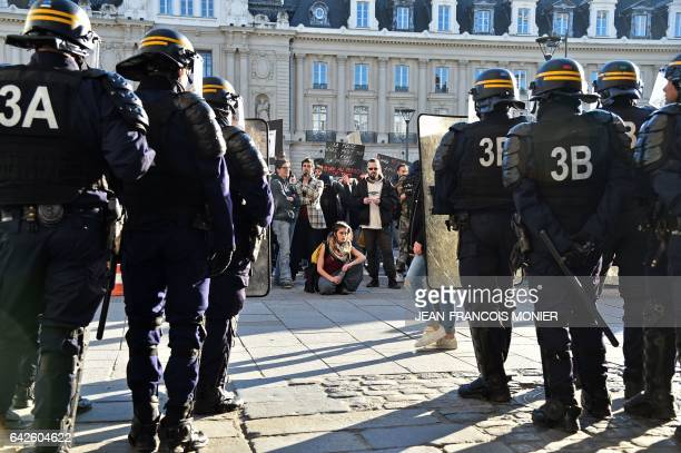 Protesters face antiriot police officers during a demonstration against police brutality on February 18 2017 in Rennes following the alleged rape in...