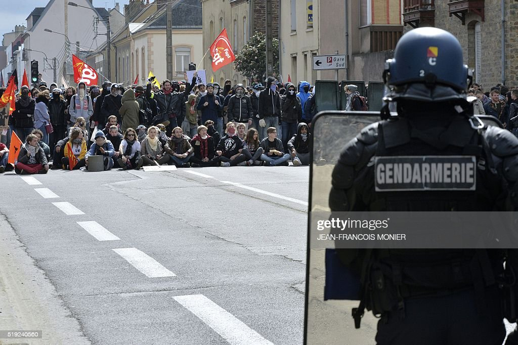 TOPSHOT Protesters face French antiriot police officer during a demonstration against the French government's labour law reforms on April 5 in Rennes...