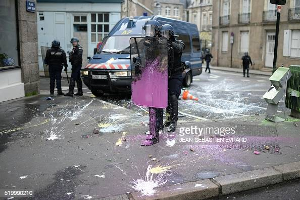 Protesters face French gendarmes on April 9 2016 in Nantes western France as they demonstrate against the government's planned labour law reforms...