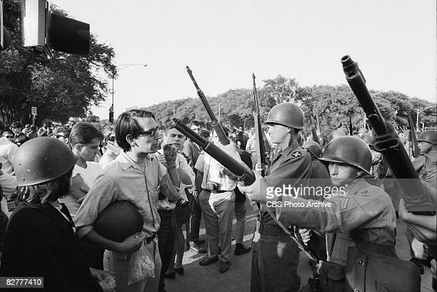 Protesters face off with armed National Guardsmen during the Democratic National Convention Chicago Illinois August 28 1968 The convention was held...