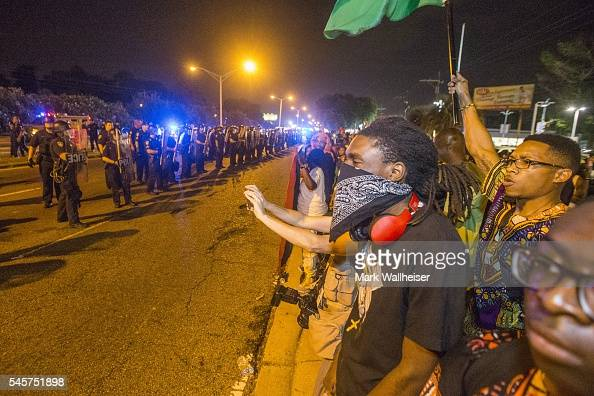 Protesters face off with Baton Rouge police for a second night in a row on July 9 2016 in Baton Rouge Louisiana Alton Sterling was shot by a police...