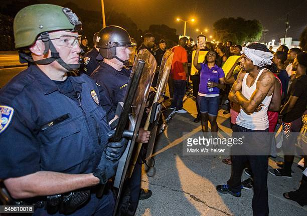 Protesters face off with Baton Rouge police in riot gear across the street from the police department on July 8 2016 in Baton Rouge Louisiana Alton...