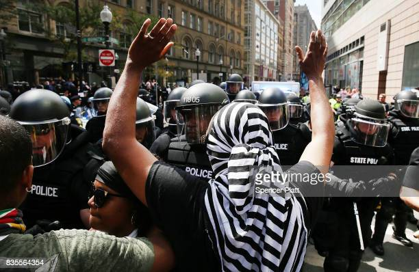 Protesters face off with riot police following a march in Boston against a planned 'Free Speech Rally' just one week after the violent 'Unite the...