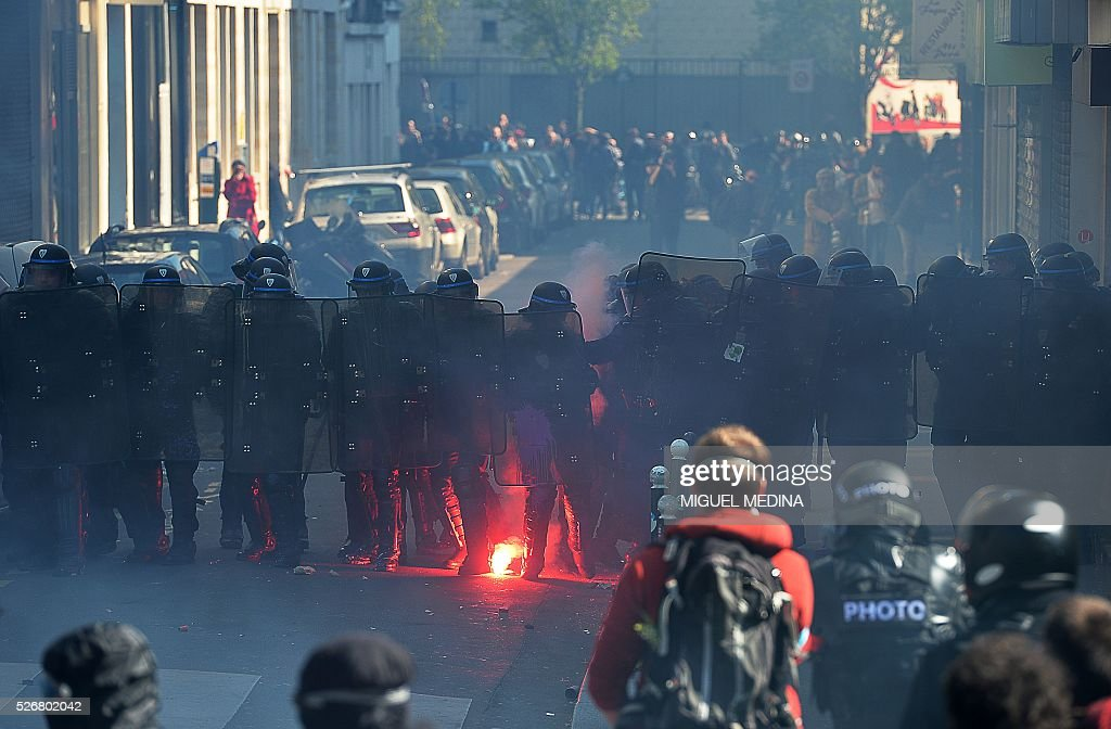 Protesters face police during clashes at a traditional May Day demonstration on May 1, 2016, in Paris.