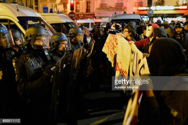 Protesters face the riot police during an anti police brutality demonstration on February 15 2017 in Paris France Violent protests have broken out...