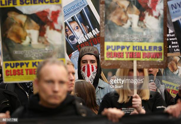 Protesters for 'Stop Huntingdon Animal Cruelty' march through London's financial district on February 27 2009 in London The antivivisection...