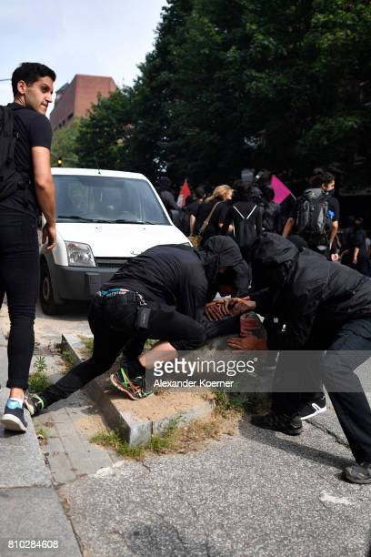 Protesters form barricades as they gather to participate in an antiG20 march on July 7 2017 in Hamburg Germany Authorities are braced for largescale...