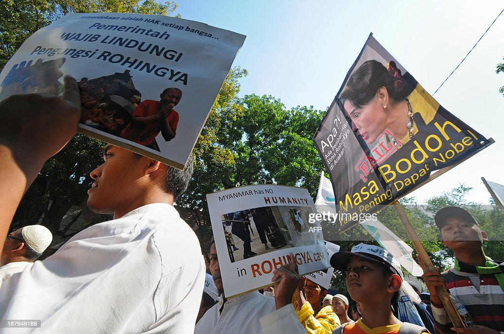 Protesters from a hardline Muslim group demand that the Nobel Peace Prize award be revoked from Nobel lauriate Aung San Suu Kyi (pictured on placard R) during anti-Myanmar protests in Solo, Central Java, on May 3, 2013. The protest highlighted the growing anger in Muslim-majority Indonesia over a string of religious clashes in largely-Buddhist Myanmar, that have left many minority Muslims dead and tens of thousands displaced. Meanwhile, two Indonesians were detained over a plot to bomb the Myanmar embassy in Jakarta, officials said. AFP PHOTO / ANWAR MUSTAFA