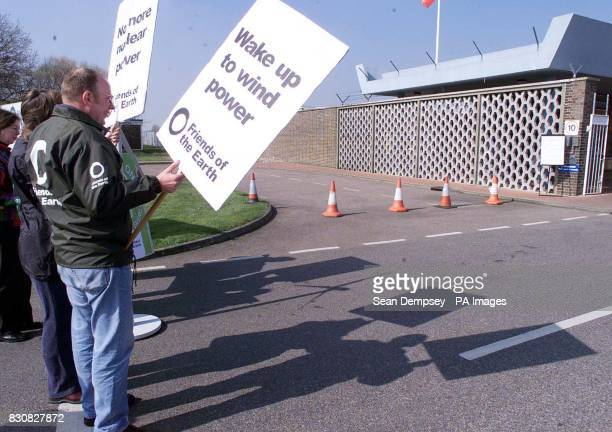 Protesters from environmental group Friends of the Earth protest outside the Bradwell nuclear power station in BradwellonSea in Essex which comes to...