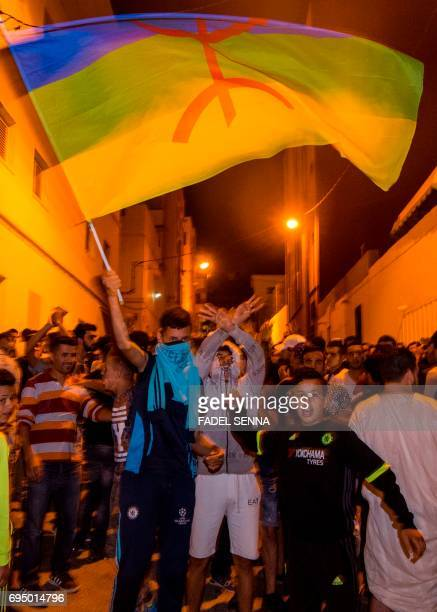 Protesters from Rif movement 'Hirak' shout slogans during a demonstration against the government in Al Hoceima city on June 11 2017 / AFP PHOTO