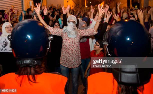 Protesters from Rif movement 'Hirak' shout slogans during a demonstration against the government in Al Hoceima city on June 11 2017 / AFP PHOTO /...