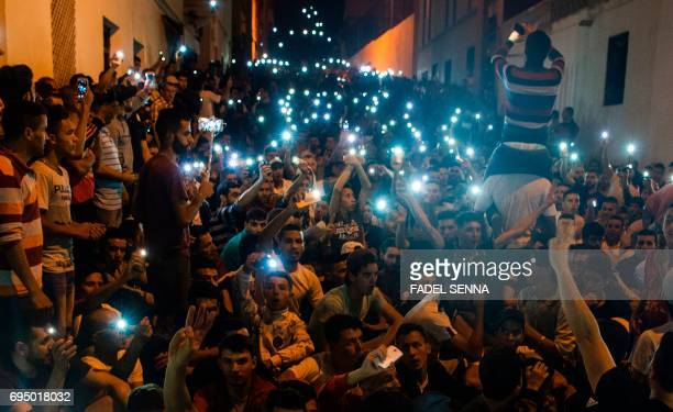 CORRECTION Protesters from Rif movement 'Hirak' shout slogans during a demonstration against the government in Al Hoceima city on June 11 2017 / AFP...