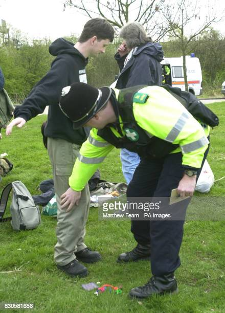 Protesters from SHAC are searched by Police as they gather for a rally against Huntingdon Life Sciences at South Mimms service station on the M25...