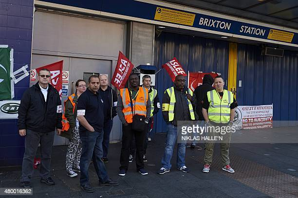 Protesters from the ASLEF and RMT unions stand at the locked gates of Brixton underground station during a tube strike in London on July 9 2015...
