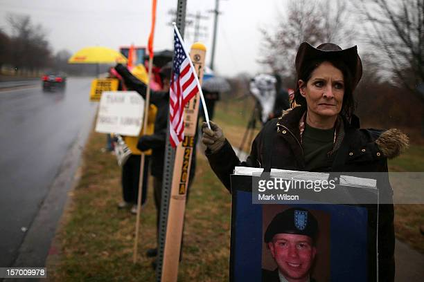 Protesters from the Bradley Manning Support Group hold signs during a rally at the entrance to Fort George G Meade on November 27 2012 in Fort Meade...