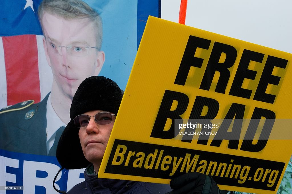 A protesters from the Bradley Manning Support Group holds a sign during a rally at the entrance of Fort George G. Meade military base in Fort Meade, Maryland on November 27, 2012. Manning is accused of downloading 260,000 US diplomatic cables, videos of US air strikes and US military reports from Afghanistan and Iraq between November 2009 and May 2010 and turning them over to WikiLeaks in what has been called one of the most serious intelligence breaches in US history.
