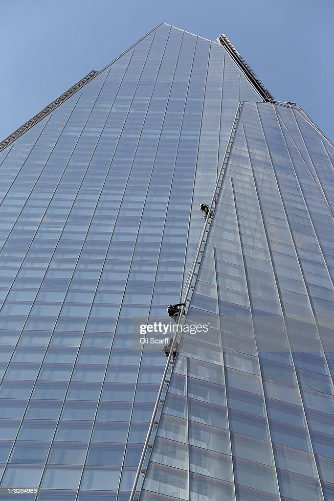 Protesters from the environmental charity Greenpeace attempt to scale the tallest building in western Europe, The Shard, in a bid to unveil a giant banner from the top on July 11, 2013 in London, England. The six female protesters began their unauthorised ascent of the 310 metre high skyscraper shortly after 4am with the intention of highlighting the environmental damage caused by drilling for oil in the Arctic by Shell.