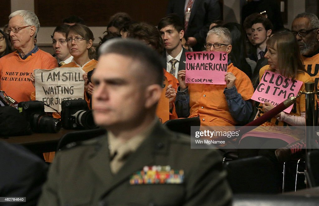 Protesters from the group Code Pink attend a hearing about the Guantanamo Detention Facility by the Senate Armed Services Committee on Capitol Hill...